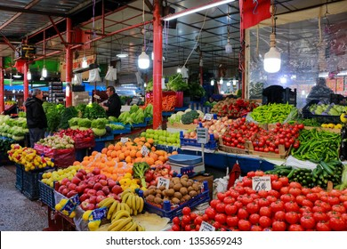 Sivas-Turkey,20 March 2019:Farmer's Market Stand,Salesman and Costumer. Salesman selling fruits and vegetables.Traditional Local Market in Sivas. Greengrocer selling farmer's produce. Vegetable Market
