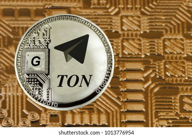 Siver coin TON oon the gold circuit background. Cryptocurrency TON from telegram.