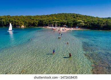 Sivota, Greece - Agust 3, 2019: Aerial drone bird's eye view of Bella Vraka Beach with turquoise sea in complex islands in Sivota area, Ionian sea, Epirus, Greece