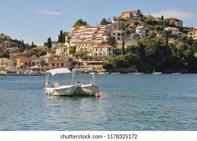 Sivota, Greece - September 5th, 2018: Two small boats in the harbour of the  village of Sivota in the north west of mainland Greece.