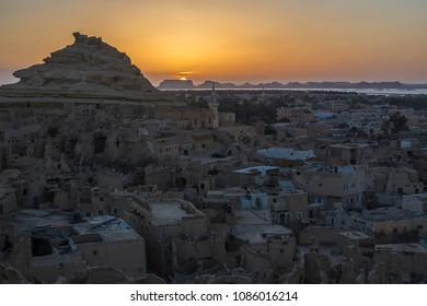 SIWA, EGYPT - April 2018: Beautiful sunset at Siwa oasis. Shali fortress ruins, Siwa oasis old town, Egypt