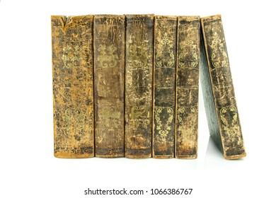Six aged ancient old leather books standing, studio shot on white.
