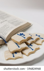 Six (bible shaped) cookies on white plate with bible psalms