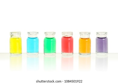 six bottles with different colors on white