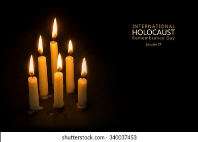 Six burning candles against a black background, text International Holocaust Remembrance Day, January 27