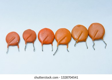 Six ceramic capacitors. Different siize capacitors. On white background