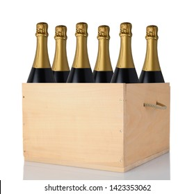 Six Champagne bottles in a wooden crate. Vertical format isolated on white with reflection.