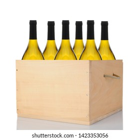 Six Chardonnay wine bottles in a wooden crate. Vertical format isolated on white with reflection.