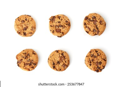 six chocolate cookies on white background top view