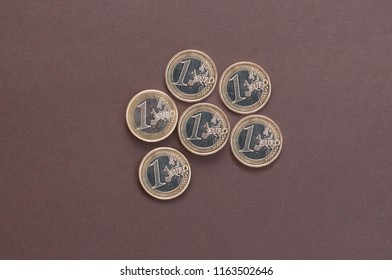 six coins in one Euro on a dark background top view