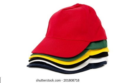Six Colored Caps Stacked, Isolated on White Background