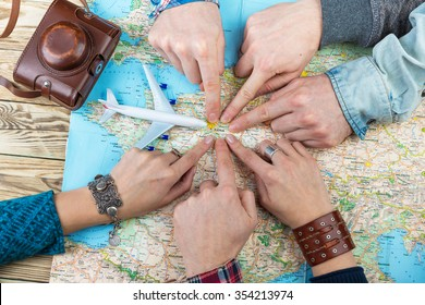 six cool friends are planning euro trip. The company of six gay friends are planning trip to France. Together point to Paris. The unanimous decision. Happy tourists. Top view. Buy plane tickets soon!