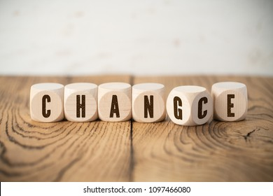 "six cubes showing the words ""change"" and ""chance"" at the same time"