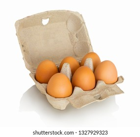 Six domestic bio-eggs in carton box, isolated on white background with shadow reflection. With clipping path. Organic eggs from farm in cardboard package.