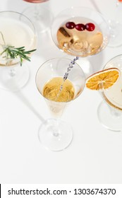 Six easy Champagne cocktails on white background. Close up view of six sparkling wine drinks, selective focus