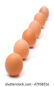 Six eggs in a diagonal line. Selective focus