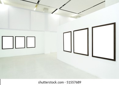 Six empty frames in the museum