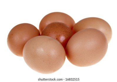 Six fresh egg with brown crust isolated on white background