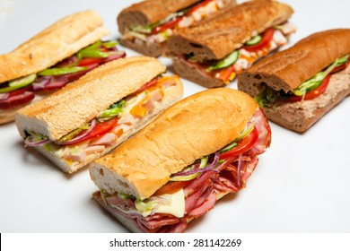 Six fresh sandwiches.Assorted delicious baguette sandwiches