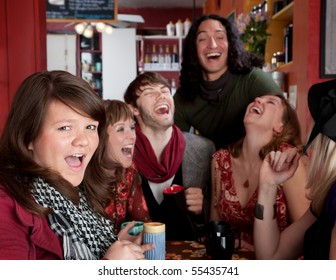 Six friends having an embarassingly good time at a cafe