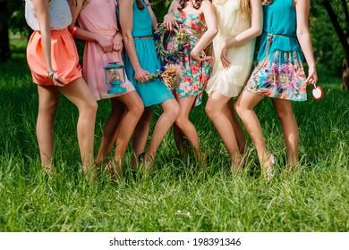 six girls in colored dresses feet
