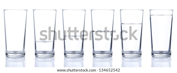 Six glasses with cold still water isolated on white background