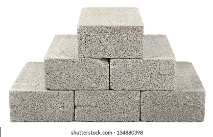 Six gray concrete construction blocks stacked together in the shape of a pyramid. Isolated on white background.