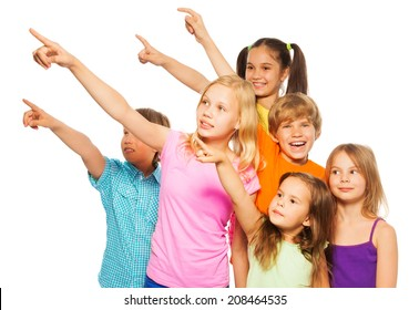 Six happy kids pointing fingers