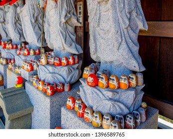 Six Jizo (stone statue) and small daruma (good-luck doll) in a temple of Izunokuni, Shizuoka Prefecture, Japan