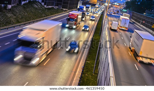 Six lane controlled-access highway in Poland by night.