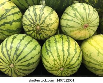 Six mini watermelons at the market