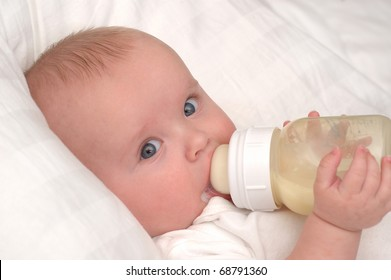 Six month old baby boy drinking his bottle