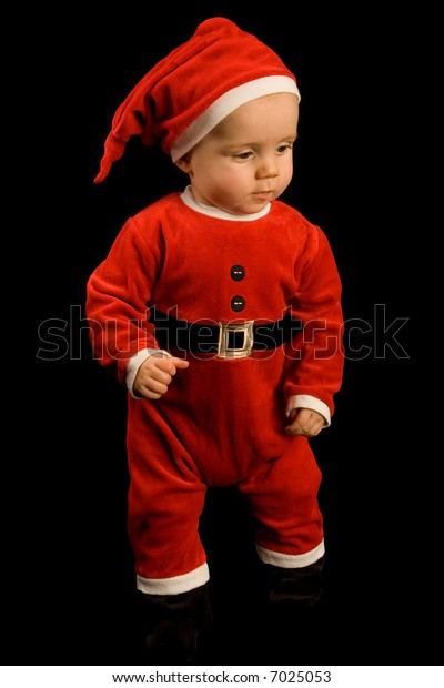 Six month old baby boy in santa outfit