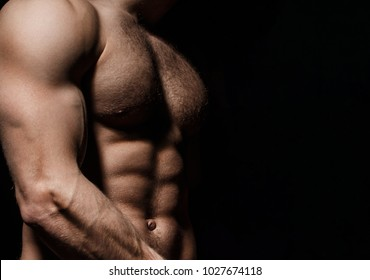 Six pack, abs, strong chest. Sexy muscular male torso six packs, ab. Athletic man training with naked chest and strong biceps on hands. Strong male, torso man. Sportsman, muscles, athlete, naked torso