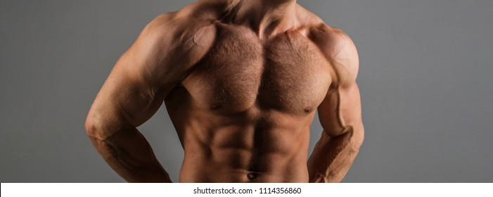 Six pack, abs, strong chest. Sexy muscular male torso six packs, ab. Strong male, torso man. Sportsman, muscles, athlete, naked torso. Athletic man training with naked chest and strong biceps on hands