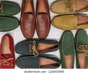 Six pairs of genuine suede leather shoes and footwear on a plain white background. These colorful shoes pop and show men's style and fashion.