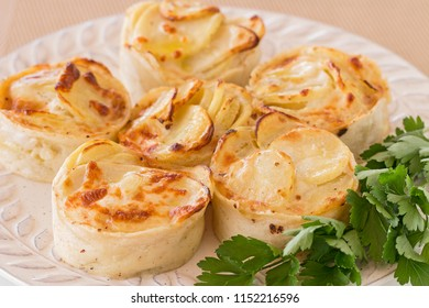 Six potatoes gratin and parsley.