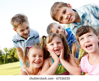 Six preschool friends looking in camera and laughing