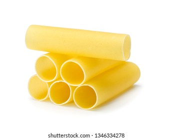 six raw cannelloni pasta tubes stacked, isolated on white