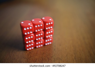 Six red dice on a table