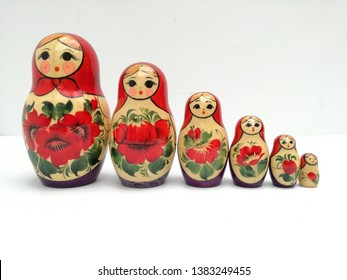 Six Russian Stacking Dolls in a line
