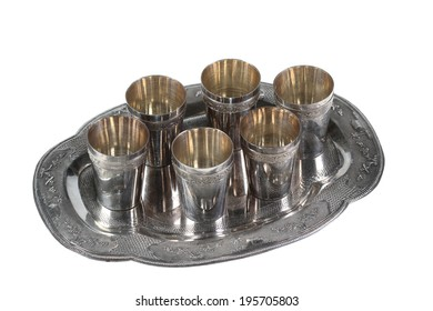 Six silver glasses on a silver tray. Isolated