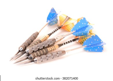 Six sport darts in blue and gold (focus on forefront). Image isolated on white studio background.