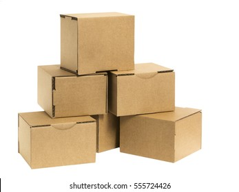 Six stacked small brown cardboard boxes isolated on white.