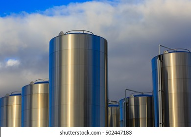 Six stainless steel milk tanks for a cheese factory.