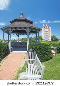 the six story building known as The Tower at Montauk  seen from Montauk village green with gazebo and benches in The Hamptons New York