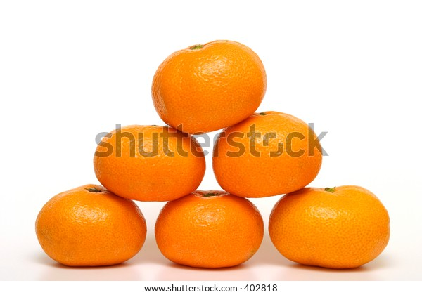 Six tangerines arranged into a pyramid