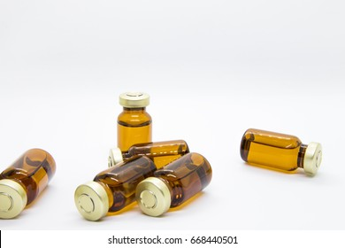 Six transparent ampules of water drug for injection such as dexamethasone or other steroids in isolated white background