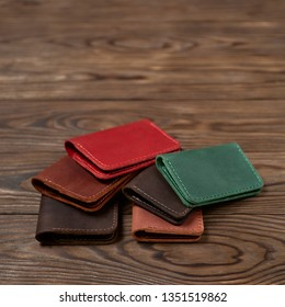 Six two-pocket leather handmade cardholder. Cardholders lies one on another. Stock photo on blurred background.