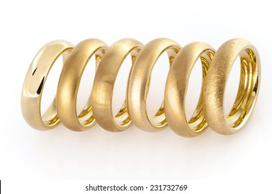 Six wedding rings with different surface to help choose the perfect ring isolated on white